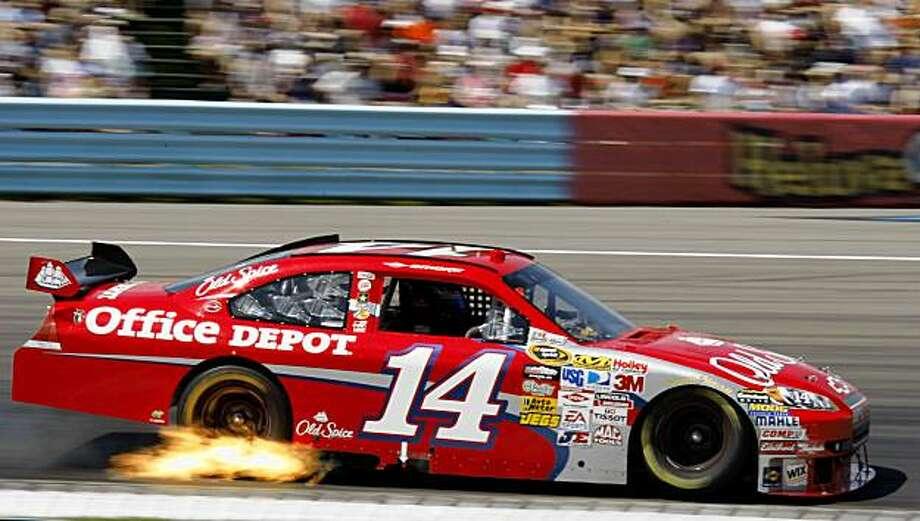 Tony Stewart drives through turn 1 during the NASCAR Sprint Cup Series auto race in Watkins Glen, N.Y., Monday, Aug. 10, 2009. Stewart won the race. (AP Photo/ David Duprey) Photo: David Duprey, AP