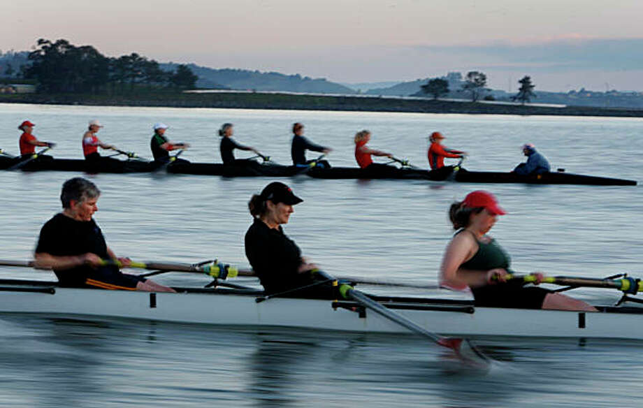 The black team goes head-to-head against the red team in a friendly race between members of the Marin Rowing Association in Greenbrae, Calif., on Saturday, Feb. 7, 2009. Photo: Paul Chinn, The Chronicle
