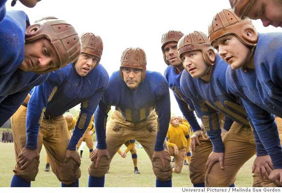 "In this image released by Universal Pictures George Clooney, center, leads the huddle in a scene from ""Leatherheads."" (AP Photo/Universal Pictures, Melinda Sue Gordon) **NO SALES** Photo: Melinda Sue Gordon"
