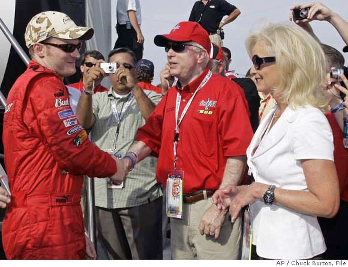 ###Live Caption:** FILE ** Sen. John McCain, center, and his wife Cindy, right, greets NASCAR driver Dale Earnhardt Jr, left, prior to the Coca-Cola 600 NASCAR auto race at Lowe's Motor Speedway in Concord, N.C. in this May 27, 2007, file photo. Budweiser, then NASCAR's official beer, is brewed by Anheuser-Busch Cos. Inc., whose products have made Cindy McCain and her family a fortune. The McCains' marriage has mixed business and politics from the beginning, according to an expansive review by The Associated Press of thousands of pages of campaign, personal finance, real estate and property records nationwide. (AP Photo/Chuck Burton, File)###Caption History:** FILE ** Sen. John McCain, center, and his wife Cindy, right, greets NASCAR driver Dale Earnhardt Jr, left, prior to the Coca-Cola 600 NASCAR auto race at Lowe's Motor Speedway in Concord, N.C. in this May 27, 2007, file photo. Budweiser, then NASCAR's official beer, is brewed by Anheuser-Busch Cos. Inc., whose products have made Cindy McCain and her family a fortune. The McCains' marriage has mixed business and politics from the beginning, according to an expansive review by The Associated Press of thousands of pages of campaign, personal finance, real estate and property records nationwide. (AP Photo/Chuck Burton, File)###Notes:John McCain, Dale Earnhardt, Cindy McCain###Special Instructions:MAY 27, 2007 FILE PHOTO
