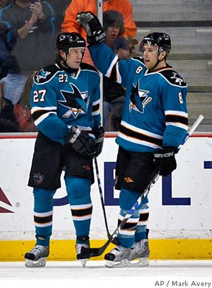 ###Live Caption:San Jose Sharks, from left, Jeremy Roenick, and Joe Pavelski celebrate Roenick's goal against the Anaheim Ducks in the second period of an NHL hockey game in Anaheim, Calif., Friday, March 28, 2008. (AP Photo/Mark Avery)###Caption History:San Jose Sharks, from left, Jeremy Roenick, and Joe Pavelski celebrate Roenick's goal against the Anaheim Ducks in the second period of an NHL hockey game in Anaheim, Calif., Friday, March 28, 2008. (AP Photo/Mark Avery)###Notes:Joe Pavelski, Jeremy Roenick###Special Instructions:EFE OUT Photo: Mark Avery