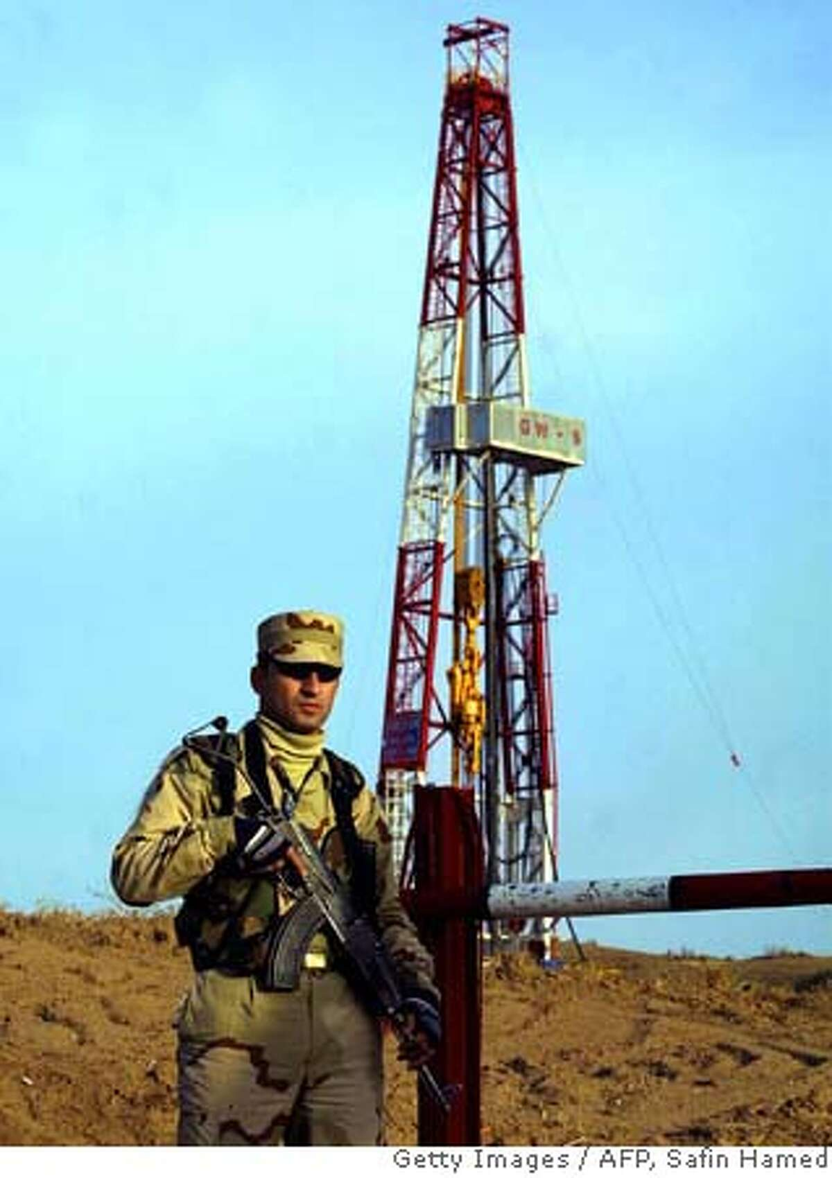 ###Live Caption:KAPROKE, Iraq: Chevron Corp. and other international oil companies are negotiating with the Iraq Ministry of Oil to squeeze more petroleum from the country's aging fields, according to published reports. Getting the oil is a dangerous proposition as evidenced by this Kurdish Peshmerga guarding a Norwegian company's drilling site in Kaproke in 2005. drilling site 29 November 2005 of a Norwegian oil company DNO who started oil prospecting in the village of Kaproke in northern Iraqi Kurdistan zone. Norway's media said DNO is the foreign company to start first drilling since the 2003 fall of Saddam Hussein's regime. AFP PHOTO/SAFIN HAMED (Photo credit should read SAFIN HAMED/AFP/Getty Images)###Caption History:KAPROKE, Iraq: A Kurdish Peshmerga guards a drilling site 29 November 2005 of a Norwegian oil company DNO who started oil prospecting in the village of Kaproke in northern Iraqi Kurdistan zone. Norway's media said DNO is the foreign company to start first drilling since the 2003 fall of Saddam Hussein's regime. AFP PHOTO/SAFIN HAMED (Photo credit should read SAFIN HAMED/AFP/Getty Images)###Notes:A Kurdish Peshmerga guards a drilling si###Special Instructions:DV