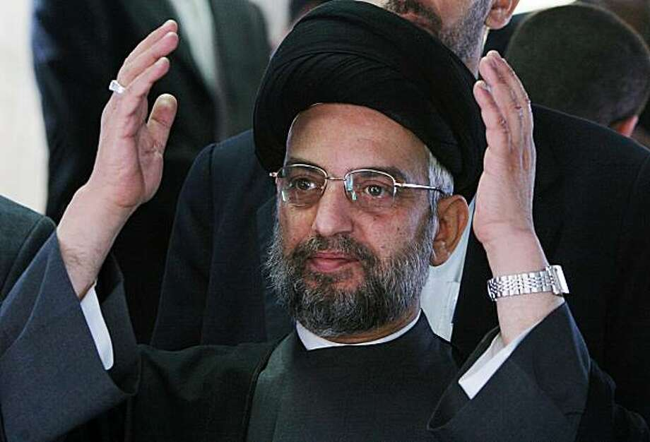 FILE - In this April 8, 2006 file photo, Abdul Aziz al-Hakim, the leader of the Supreme Council for the Islamic Revolution in Iraq appears at a gathering of Iraqi Shiites who were protesting the suicide bombing of a mosque in Baghdad, Iraq. Abdul-Aziz al-Hakim, the scion of a revered clerical family who channeled rising Shiite Muslim power after the fall of Saddam Hussein to become one of Iraq's most influential politicians, died Wednesday Aug. 26, 2009 in Iran, the country that was long his key ally. He was 59.(AP Photo/Karim Kadim, File) Photo: Karim Kadim, File, AP