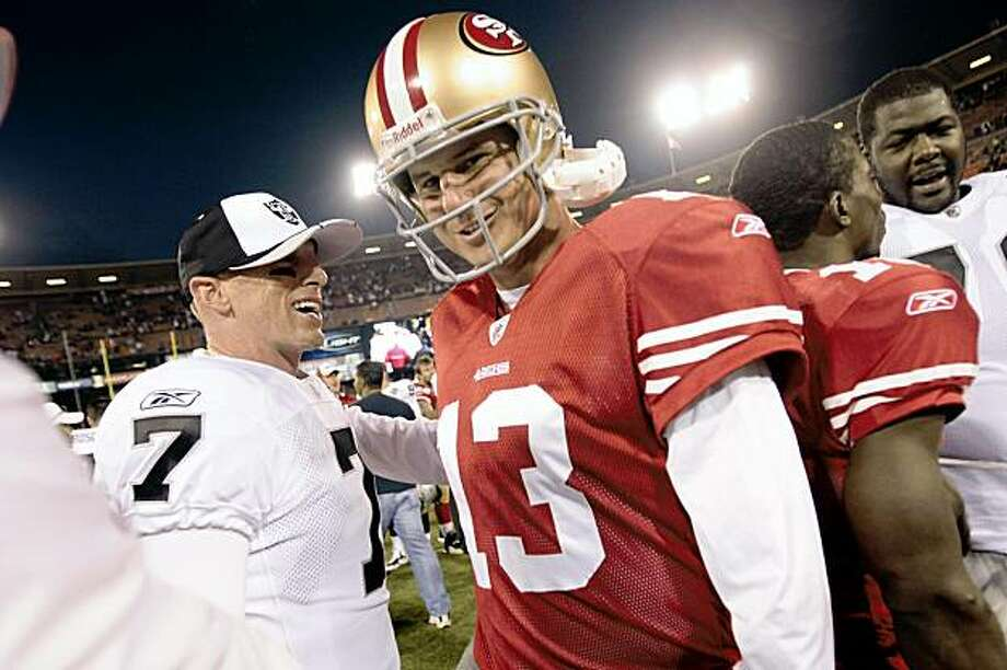 SAN FRANCISCO - AUGUST 22:  Oakland Raiders quarterback Jeff Garcia #7 and San Francisco 49ers quarterback Shaun Hill #13 meet at the center of the field after the San Francisco 49ers hosted the Oakland Raiders at Candlestick Park August 22, 2009 in San Francisco, California.  (Photo by David Paul Morris/Getty Images) Photo: David Paul Morris, Getty Images