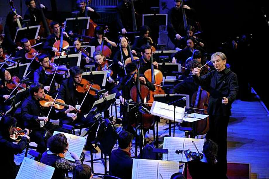 In this image released by Stefan Cohen Photography, Conductor Michael Tilson Thomas, standing right, rehearses with the YouTube Symphony Orchestra at Carnegie Hall in New York on Wednesday, April 15, 2009. Photo: Stefan Cohen, AP / ONLINE_CHECK