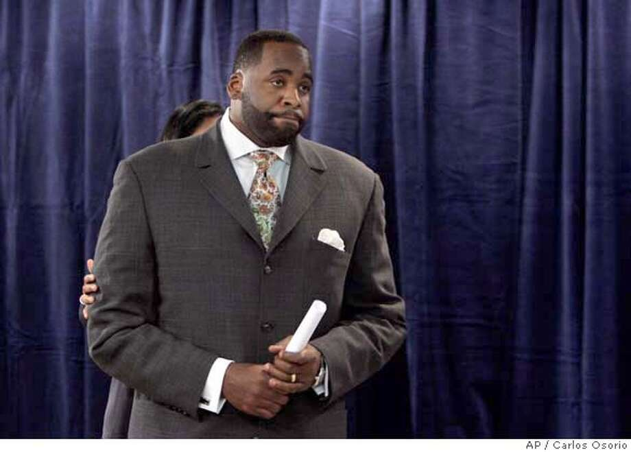 "###Live Caption:Detroit Mayor Kwame Kilpatrick steps away from the microphone after addressing the media during a news conference in the mayor's office in Detroit, Monday, March 24, 2008. Kilpatrick, a one-time rising star in American urban politics who embraced his ""Hip-Hop Mayor"" image as Detroit's youngest elected leader, was charged Monday with perjury and other counts after sexually explicit text messages surfaced that appear to contradict his sworn denials of an affair with a top aide. Two hours after the prosecutor's announcement, Kilpatrick said he was ""deeply disappointed,"" but not surprised at being charged. (AP Photo/Carlos Osorio)###Caption History:Detroit Mayor Kwame Kilpatrick steps away from the microphone after addressing the media during a news conference in the mayor's office in Detroit, Monday, March 24, 2008. Kilpatrick, a one-time rising star in American urban politics who embraced his ""Hip-Hop Mayor"" image as Detroit's youngest elected leader, was charged Monday with perjury and other counts after sexually explicit text messages surfaced that appear to contradict his sworn denials of an affair with a top aide. Two hours after the prosecutor's announcement, Kilpatrick said he was ""deeply disappointed,"" but not surprised at being charged. (AP Photo/Carlos Osorio)###Notes:Kwame Kilpatrick###Special Instructions: Photo: Carlos Osorio"