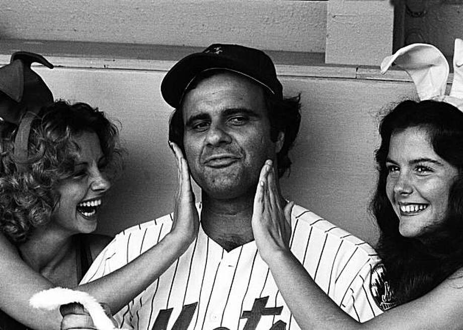 New York Mets manager Joe Torre reacts as two playboy bunnies rub their lipstick off his face after giving him a dual kiss in the Shea Stadium dugout prior to the Mets game with the Chicago Cubs Tueaday night, July 12, 1977. Bunnies Desiree, left, and Robin came to Shea to invite Torre to be a coach for their bunny team at an August 7th game with the New Jersey State Police and FBI team all benifit the March of Dimes. Photo: Ray Stubblebine