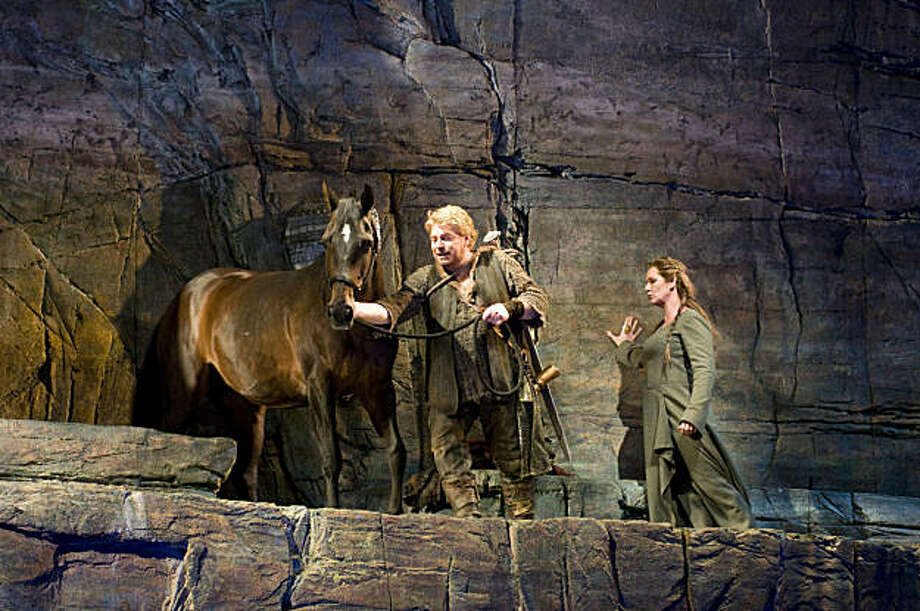 "Stig Andersen (Siegfried) and Janice Baird (Brünnhilde), with Star (Grane) in Wagner's ""Götterdämmerung"" at the Seattle Opera Photo: Rozarii Lynch"