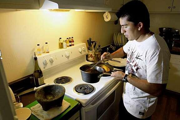 Gonzalo Guzman, chef at Nopalito, his San Francisco, Calif., home preparing Squash Blossom Empanadas for the Chef's Night In column on Wednesday, July 15, 2009.