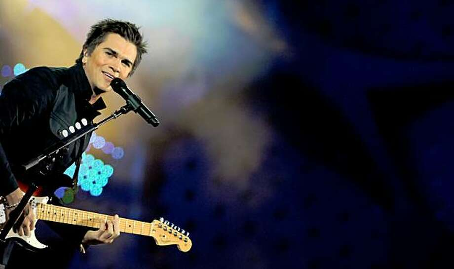 Colombian singer Juanes performs during the 50th Vina del Mar International Song Festival February 24, 2009 in Vina del Mar, Chile. AFP PHOTO/MARTIN BERNETTI (Photo credit should read MARTIN BERNETTI/AFP/Getty Images) Photo: Martin Bernetti, AFP/Getty Images