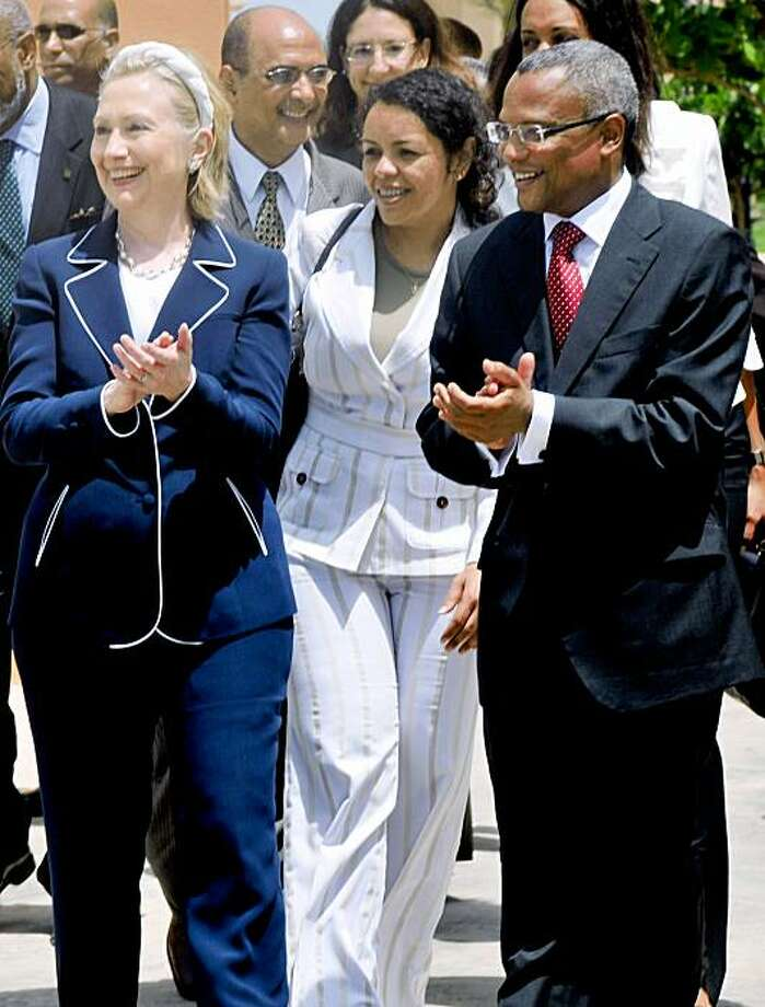 US Secretary of State Hillary Clinton (L) applauds along with prime minister Cape Verde Jose Maria Neves (R) in Sal on August 14, 2009.  Hillary Clinton has set a new tone in US relations with Africa on a whirlwind seven-nation trip, sometimes ruffling feathers with a tough love message that Africans must tackle their own problems. AFP PHOTO/ STR (Photo credit should read STR/AFP/Getty Images) Photo: STR, AFP/Getty Images