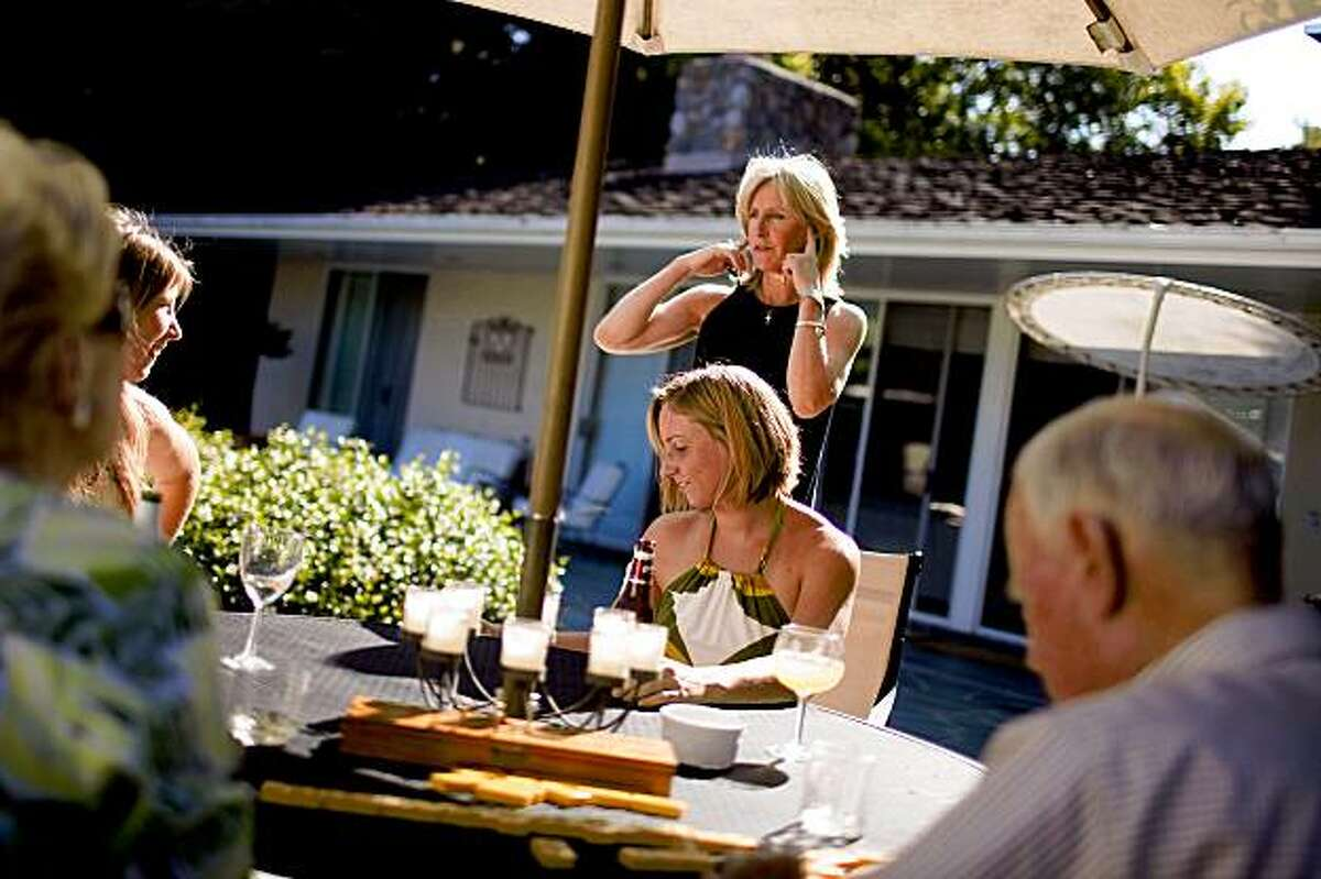 The Clark family and their grandparents hangs out by the pool at their Atherton, Calif. home on Sunday, July 12, 2009. The Clarks are one of many multigenerational-family living together as the the concept continues to grow in recent years for various reasons ranging from the current economy to the idea of preserve the family unit.
