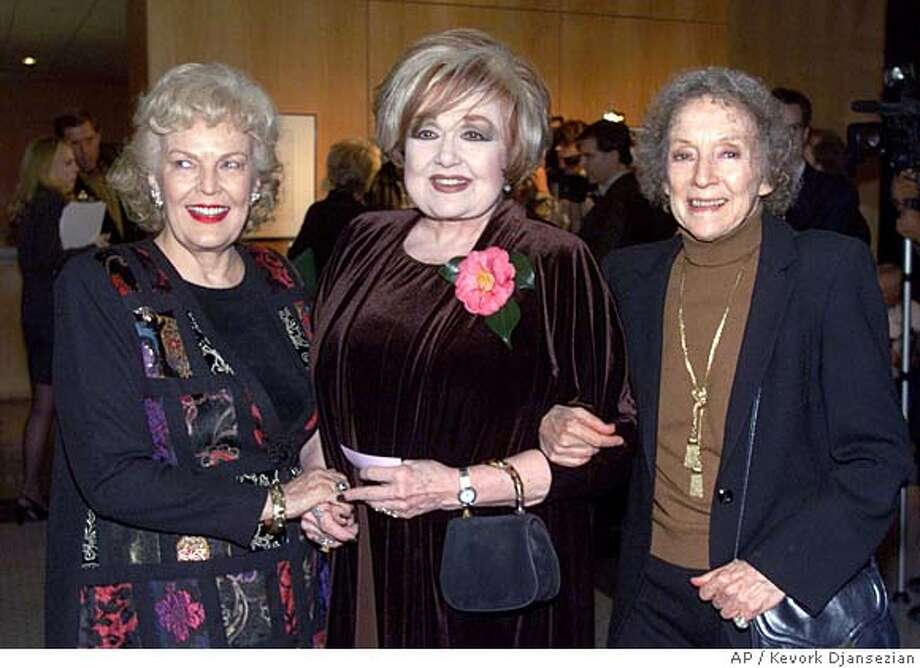 """Edie Adams, center  Actresses Evelyn Keyes, right, who starred in the 1955 film """"The Seven Year Itch,"""" Edie Adams, center, who starred in the 1960 film """"The Apartment"""" and June Haver, widow of actor Fred MacMurray, pose for photgraphers during a tribute to legendary director Billy Wilder at the Academy of Motion Pictures Arts and Sciences Thursday, Jan.13, 2000, in Beverly Hills, Calif. The evening of film clips and personal appearances serves as the kick-off event for a three-week retrospective of 27 Wilder written and/or directed films. (AP Photo/Kevork Djansezian)  Ran on: 04-06-2008  Edie Adams (center) at a Billy Wilder tribute in 2000 with June Haver (left) and Evelyn Keyes. Photo: Ap KEVORK DJANSEZIAN"""