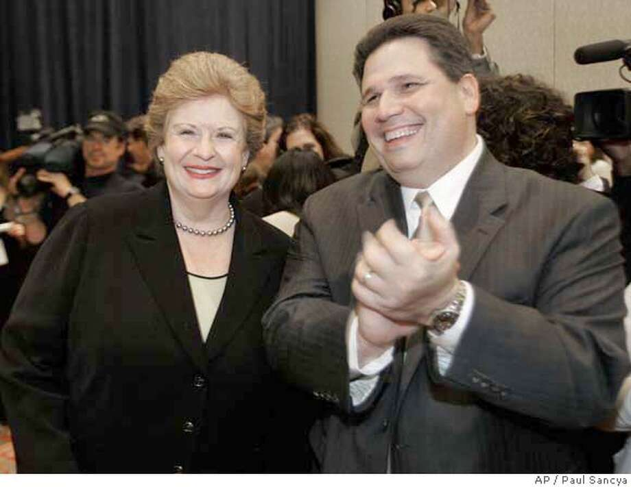 ###Live Caption:**FILE** U.S. Sen. Debbie Stabenow, D-Mich., left, and her husband Thomas Athans, right, are shown at an election night rally in Detroit, Nov. 7, 2006. Athans told police on Feb. 26, 2008 he used the Internet to make a date with a prostitute and paid her $150 for sex at a hotel in Troy, Mich., according to a police report. (AP Photo/Paul Sancya)###Caption History:**FILE** U.S. Sen. Debbie Stabenow, D-Mich., left, and her husband Thomas Athans, right, are shown at an election night rally in Detroit, Nov. 7, 2006. Athans told police on Feb. 26, 2008 he used the Internet to make a date with a prostitute and paid her $150 for sex at a hotel in Troy, Mich., according to a police report. (AP Photo/Paul Sancya)###Notes:Debbie Stabenow, Thomas Athans###Special Instructions:NOV. 7, 2006 FILE PHOTO Photo: Paul Sancya