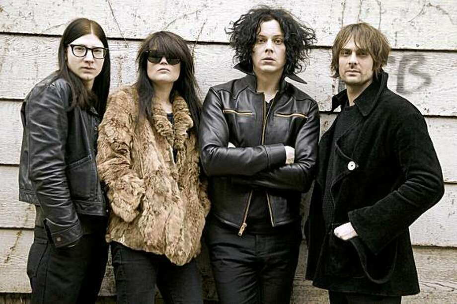 The Dead Weather is the latest side-project by the White Stripes frontman Jack White. The Dead Weather, from left, Jack Lawrence, Alison Mosshart, Jack White and Dean Fertita pose in Nashville, Tenn., Wednesday, March 11, 2009. (AP Photo/Ed Rode) Photo: Ed Rode, AP
