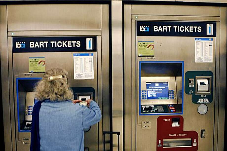 Catherine Siskron of Berkeley uses the BART ticket machine to make change at Montgomery BART station on Thursday July 30, 2009 in San Francisco, Calif. Photo: Lea Suzuki, The Chronicle