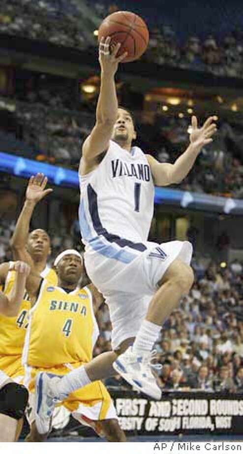 ###Live Caption:Villanova's Scottie Reynolds (1) beats Siena's Alex Franklin (42) and Tay Fisher (4) to the basket to score during the first half of an NCAA Midwest Regional second round tournament basketball game Sunday March 23, 2008 in Tampa, Fla. (AP Photo/Mike Carlson)###Caption History:Villanova's Scottie Reynolds (1) beats Siena's Alex Franklin (42) and Tay Fisher (4) to the basket to score during the first half of an NCAA Midwest Regional second round tournament basketball game Sunday March 23, 2008 in Tampa, Fla. (AP Photo/Mike Carlson)###Notes:SCottie Reynolds, Tay Fisher, Alex Franklin###Special Instructions:EFE OUT Photo: Mike Carlson