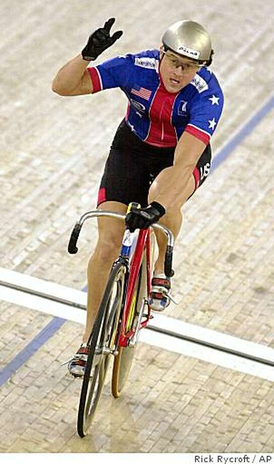 Tammy Thomas of the U.S. raises her hand in celebration after winning the women's sprint final against fellow American Tanya Lindenmuth at the World Cup Track Cycling in Sydney, Australia, Sunday, May 12, 2002.  In 2002, Thomas received a lifetime suspension for taking a steroid called norbolethone. Photo: Rick Rycroft, AP