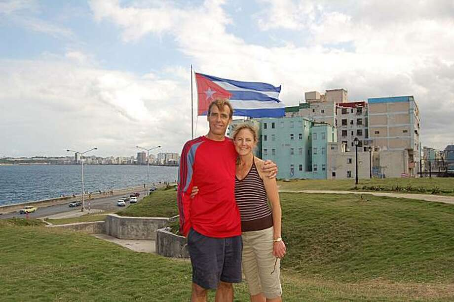 Carl & Denise Touhey, of Emerald Hills, in front of the Hotel National overlooking the malecon.
