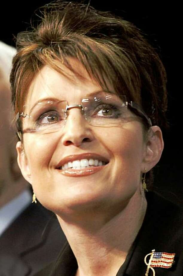 "FILE - In this Aug. 29, 2008 file photo, shows Alaska Gov. Sarah Palin. Palin  abruptly announced Friday, July 3, 2009. Former Alaska Gov. Sarah Palin called President Barack Obama's health plan ""downright evil"" Friday Aug. 7, 2009 in her first online comments since leaving office, saying in a Facebook posting that he would create a ""death panel"" that would deny care to the neediest Americans. (AP Photo/Stephan Savoia,File) Photo: Stephan Savoia, AP"