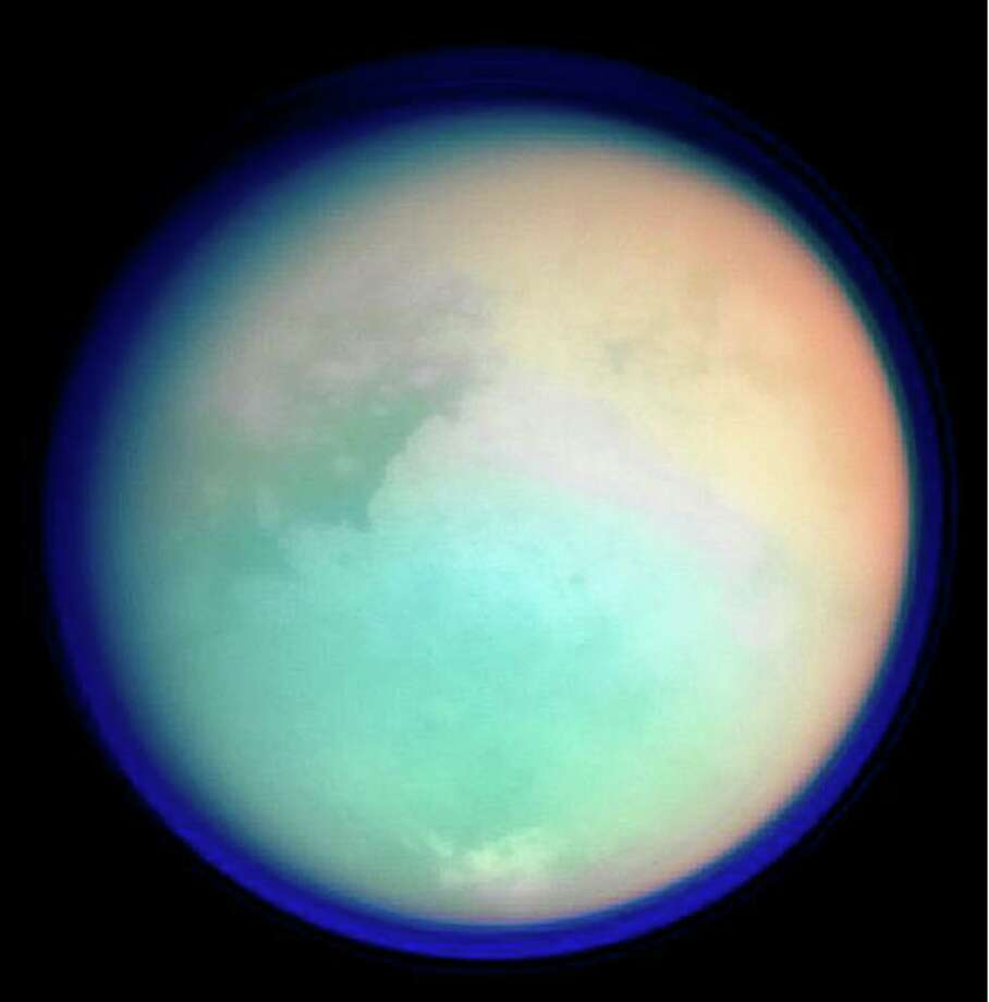 This undated NASA handout shows Saturn's moon, Titan, in ultraviolet and infrared wavelengths. The Cassini spacecraft took the image while on its mission to gather information on Saturn, its rings, atmosphere and moons. The different colors represent various atmospheric content on Titan. Photo: NASA, Getty Images
