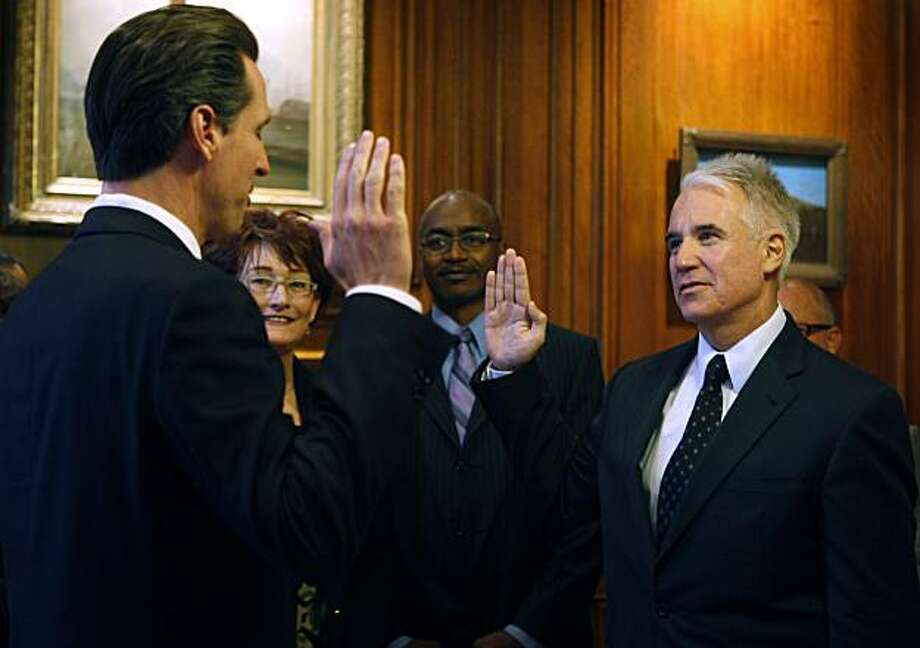 Mayor Gavin Newsom swears-in George Gascon as Chief of Police during a private ceremony in Newsom's office in San Francisco, Calif., on Friday, Aug. 7, 2009. Watching the ceremony are Theresa Sparks, out-going Police Commission president, and new commission president Joe Marshall Photo: Paul Chinn, The Chronicle