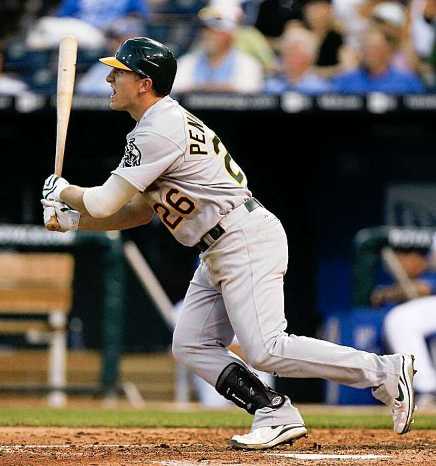Oakland Athletics' Cliff Pennington drives the ball into right for a two-run double in the fourth inning of a baseball game against the Kansas City Royals Friday, Aug. 7, 2009, in Kansas City, Mo. Tommy Everidge and Mark Ellis scored on the double. (AP Photo/Ed Zurga) Photo: ED ZURGA, AP