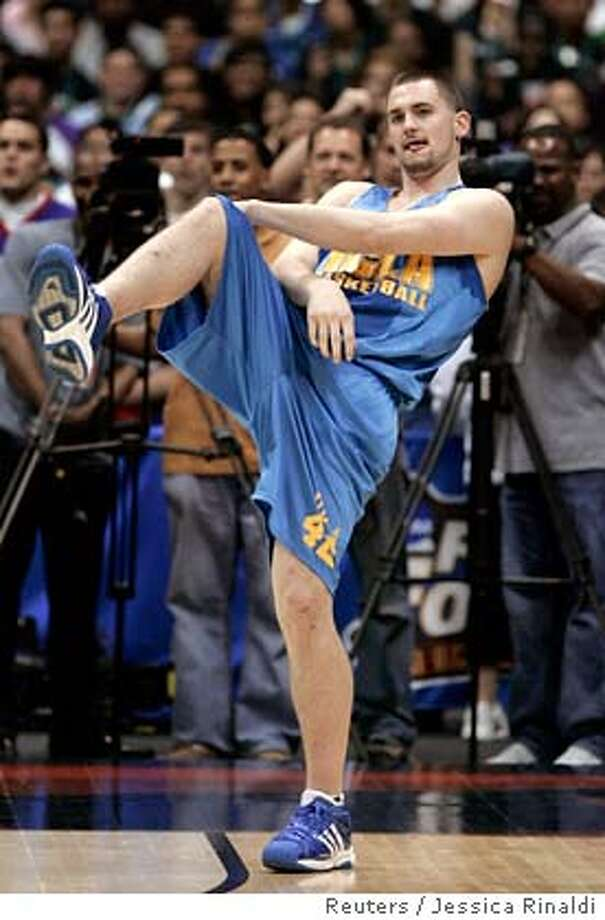 ###Live Caption:UCLA Bruins center Kevin Love reacts after missing a full court shot during practice for the Men's Final Four in San Antonio, Texas, April 4, 2008. The basketball tournament tournament begins April 5. REUTERS/Jessica Rinaldi (UNITED STATES)###Caption History:UCLA Bruins center Kevin Love reacts after missing a full court shot during practice for the Men's Final Four in San Antonio, Texas, April 4, 2008. The basketball tournament tournament begins April 5. REUTERS/Jessica Rinaldi (UNITED STATES)###Notes:UCLA Bruins center Kevin Love reacts after missing a full court shot during practice for the Men's Final Four in San Antonio###Special Instructions: Photo: JESSICA RINALDI