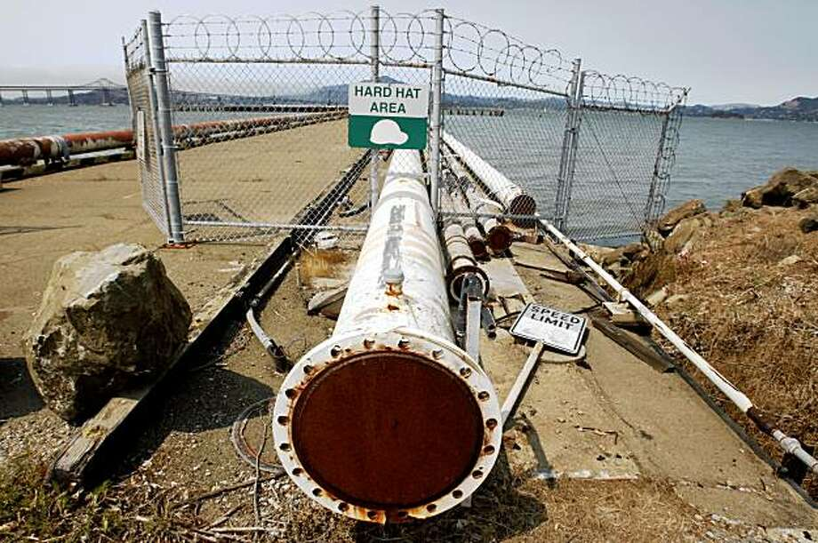 Rusty pipes extend out to the end of a pier at the old Point Molate Naval Supply Center in Richmond, Calif., on Tuesday, Aug. 11, 2009. The Guideville Band of Pomo Indians tribe may use the pier for commuter ferry service if their proposed resort and casino plan is approved. Photo: Paul Chinn, The Chronicle