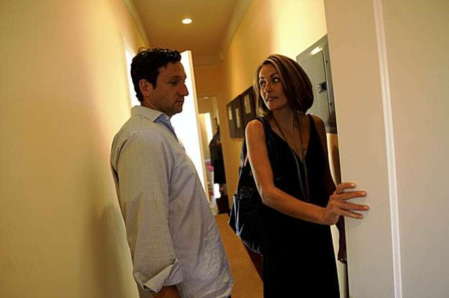 Brian Czarny (l to r) and Jessica Clifton-Czarny look over a closet in a home on Bay Street in San Francisco, Calif. on Sunday, August 16, 2009. Jessica Clifton-Czarny is using National BLS to help her find a home to buy. Photo: Lea Suzuki, The Chronicle