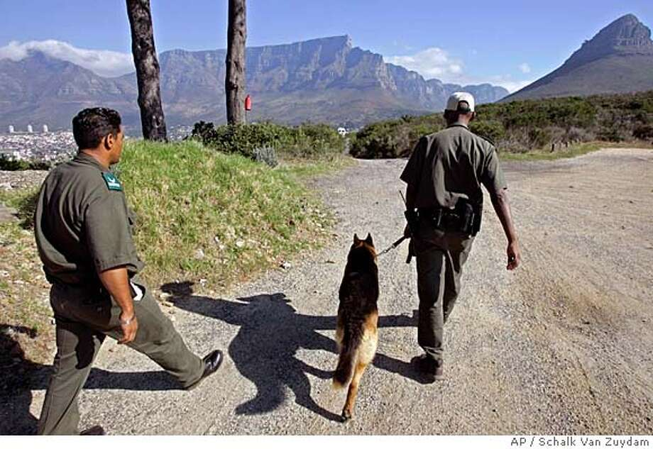 ###Live Caption:Jeremy Powell, left, and Velile Dolweni, right, patrols Signal Hill with there dog Gino in Cape Town, South Africa, Friday, Feb. 22, 2008. After months of knife-wielding thugs on Table Mountain grabbing purses and headlines, authorities are quietly confident that they are on the way to restoring the battered image of the international tourist icon by taking on the criminals. (AP Photo/Schalk van Zuydam)###Caption History:Jeremy Powell, left, and Velile Dolweni, right, patrols Signal Hill with there dog Gino in Cape Town, South Africa, Friday, Feb. 22, 2008. After months of knife-wielding thugs on Table Mountain grabbing purses and headlines, authorities are quietly confident that they are on the way to restoring the battered image of the international tourist icon by taking on the criminals. (AP Photo/Schalk van Zuydam)###Notes:###Special Instructions: Photo: Schalk Van Zuydam