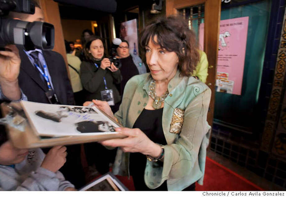 "FESTIVAL06_053_CG.JPG  Actress Lily Tomlin signs autographs on the red carpet at the Castro Theater in San Francisco, Ca., on Thursday, May 4, 2006. Closing night of the S.F. Film Festival. The film is Robert Altman's ""A Praries Home Companion,"" and stars Lily Tomlin and Virginia Madsen attended the event at the Castro Theater in San Francisco, Ca., on Thursday, May 4, 2006. Photo by Carlos Avila Gonzalez / The San Francisco Chronicle  Photo taken on 5/4/06 in San Francisco, CA. Photo: Carlos Avila Gonzalez"