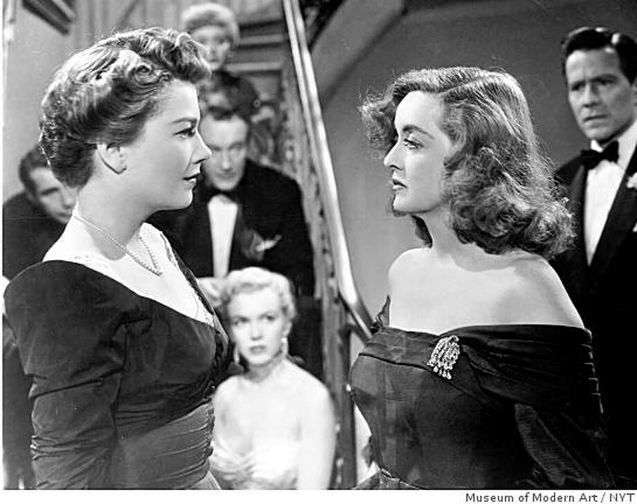 """Anne Baxter, left, and Bette Davis in the 1950 film, """"All About Eve."""" Davis, born 100 years ago this week, made her first appearance on film in 1931 and her last in 1989, and like every star of her generation she was always ready for her close-up. The difference with Davis was, she didnÕt need it.  (Museum of Modern Art/The New York Times) Photo: Museum Of Modern Art, NYT"""
