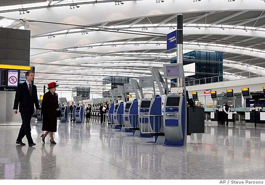 ###Live Caption:Britain's Queen Elizabeth II, accompanied by British Airports Authority CEO Stephen Nelson, arrives to open the new Terminal 5 at London's Heathrow airport, Friday March 14, 2008, after more than five years of construction at a cost of 4.3 billion pounds (US$8.6 billion, euro 5.6 billion). The new terminal, the cornerstone of the faded airport's revival plan, is designed to handle up to 30 million passengers per year and to alleviate congestion at Heathrow's other terminals, which are all slated for refurbishment or replacement in the coming years.(AP Photo/Steve Parsons-pa) ** UNITED KINGDOM OUT: NO SALES: NO ARCHIVE: **###Caption History:Britain's Queen Elizabeth II, accompanied by British Airports Authority CEO Stephen Nelson, arrives to open the new Terminal 5 at London's Heathrow airport, Friday March 14, 2008, after more than five years of construction at a cost of 4.3 billion pounds (US$8.6 billion, euro 5.6 billion). The new terminal, the cornerstone of the faded airport's revival plan, is designed to handle up to 30 million passengers per year and to alleviate congestion at Heathrow's other terminals, which are all slated for refurbishment or replacement in the coming years.(AP Photo/Steve Parsons-pa) ** UNITED KINGDOM OUT: NO SALES: NO ARCHIVE: **###Notes:###Special Instructions:UNITED KINGDOM OUT: NO SALES: NO ARCHIVE: - PHOTOGRAPH CAN NOT BE STORED OR USED FOR MORE THAN 14 DAYS AFTER THE DAY OF TRANSMISSION Photo: Steve Parsons
