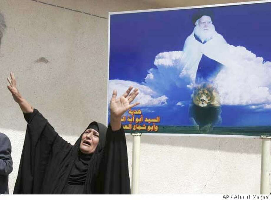 The sister of Salah Chiyad mourns during his funeral in Najaf, Iraq, Wednesday, March 26, 2008. Chiyad, a Mahdi Army fighter, was killed in Tuesday's clashes in Basra. Poster in the back depicts image of the radical Shiite cleric Muqtada al-Sadr's father, Mohammed Sadiq al-Sadr. (AP Photo/Alaa al-Marjani) Photo: ALAA AL-MARJANI
