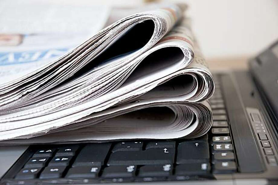 Newspaper and laptop credit: iStockphoto.com Photo: Muharrem öner, IStockphoto.com