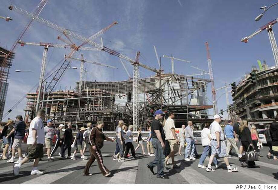 ###Live Caption:Tourists walk past the construction site of MGM Mirage's CityCenter on the Strip in Las Vegas, Tuesday, March 25, 2008. In a town enthralled with its own mythology, Las Vegas would like to hold on to one myth in particular these days: Gambling is recession proof. It's conventional wisdom characteristic of a city and an industry far more accustomed to boom than bust, but it's just not true, experts say. (AP Photo/Jae C. Hong)###Caption History:Tourists walk past the construction site of MGM Mirage's CityCenter on the Strip in Las Vegas, Tuesday, March 25, 2008. In a town enthralled with its own mythology, Las Vegas would like to hold on to one myth in particular these days: Gambling is recession proof. It's conventional wisdom characteristic of a city and an industry far more accustomed to boom than bust, but it's just not true, experts say. (AP Photo/Jae C. Hong)###Notes:###Special Instructions: Photo: Jae C. Hong