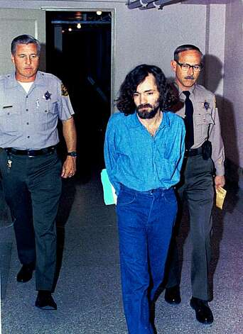 Charles Manson, head of the cult the Manson Family being escorted by deputy sheriffs on his way to court, in Los Angeles, Calif., after being charged with murder-conspiracy in the Tate-LaBianca slayings Aug. 20, 1970. Photo: AP