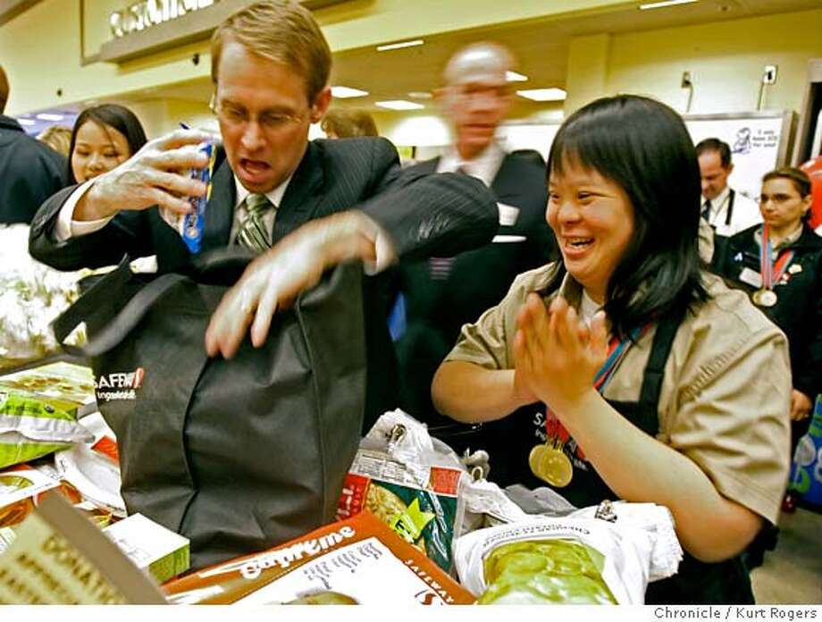 ###Live Caption:Olympic gold medalist gymnast Bart Connor bags groceries as Safeway employee and Special Olympics medalist Stephanie Ching take part in a campaign to raise money for Easter Seals and the Special Olympics on Friday, April 4, 2008 in Alameda, Calif. Ching works at a Safeway's store in Menlo Park.  Photo by Kurt Rogers / San Francisco Chronicle###Caption History:Olympic gold medalist gymnast Bart Connor bags groceries as Safeway employee and Special Olympics medalist Stephanie Ching who works at Safeway�s Menlo Park store they are taking part in a campaign to raise money or Easter Seals and the Special Olympics On Friday April 4, 2008 in Alameda , Calif  Photo By Kurt Rogers / San Francisco Chronicle###Notes:Safeway the largest employeer of people with disabilities.###Special Instructions:MANDATORY CREDIT FOR PHOTOG AND SAN FRANCISCO CHRONICLE/NO SALES-MAGS OUT Photo: Kurt Rogers