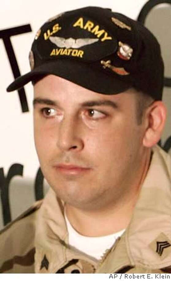 """###Live Caption:** FILE ** Iraq War disabled veteran Sgt. Peter Damon is shown at the presentation of a handicap-accessible home that was donated to him in this Thursday, Oct. 13, 2005, file photo in Middleborough, Mass. A federal appeals court in Boston ruled Thursday, March 27, 2008, ruled that a federal judge was correct to throw out Sgt. Damon's lawsuit against filmmaker Michael Moore, which claimed Moore defamed the veteran when he used a clip from a television interview without permission in the anti-war documentary """"Fahrenheit 9/11."""" (AP Photo/Robert E. Klein)###Caption History:** FILE ** Iraq War disabled veteran Sgt. Peter Damon is shown at the presentation of a handicap-accessible home that was donated to him in this Thursday, Oct. 13, 2005, file photo in Middleborough, Mass. A federal appeals court in Boston ruled Thursday, March 27, 2008, ruled that a federal judge was correct to throw out Sgt. Damon's lawsuit against filmmaker Michael Moore, which claimed Moore defamed the veteran when he used a clip from a television interview without permission in the anti-war documentary """"Fahrenheit 9/11."""" (AP Photo/Robert E. Klein)###Notes:Peter Damon###Special Instructions:OCT. 13, 2005, FILE PHOTO Photo: Robert E. Klein"""