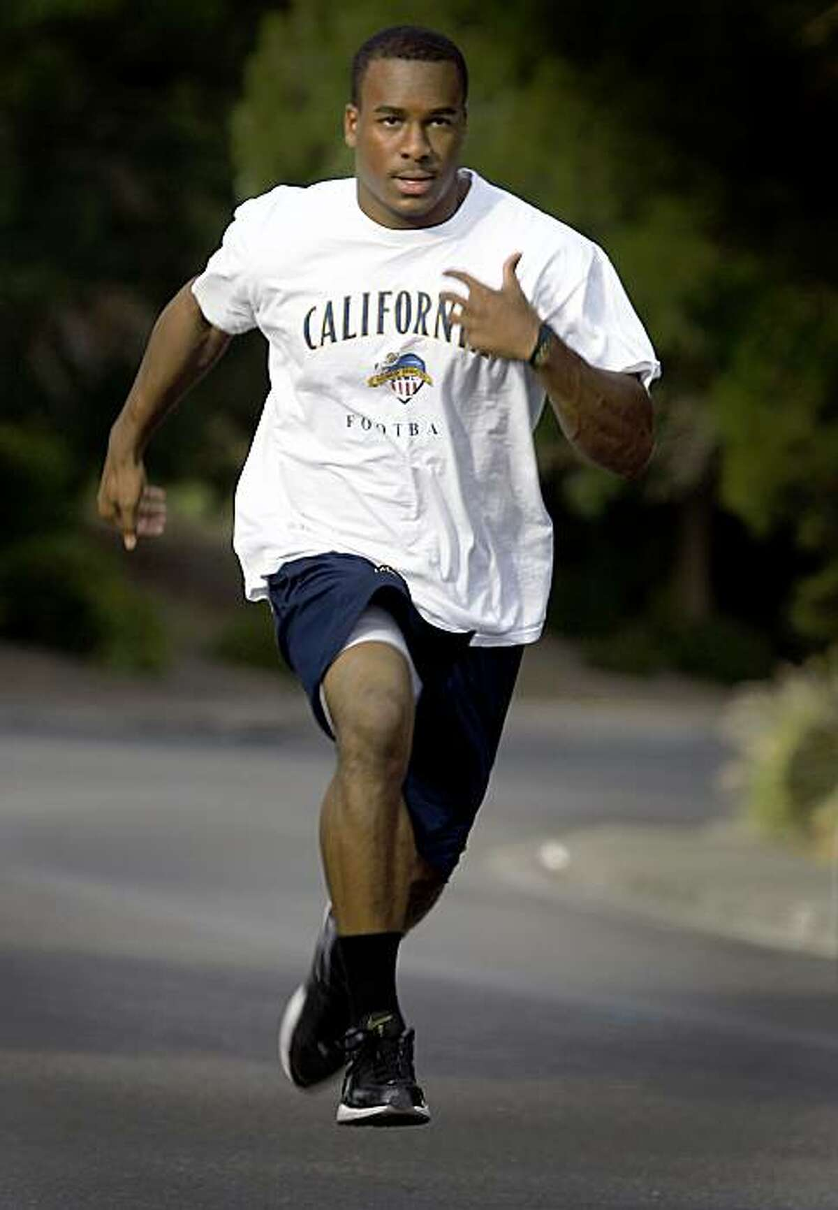 Jahvid Best sprints up a steep section of Georgia Street in Vallejo, Calif., on Wednesday, Aug. 5, 2009. The star running back for the California Golden Bears stays in shape during the off-season by running up the hill several times, two or three days a week.