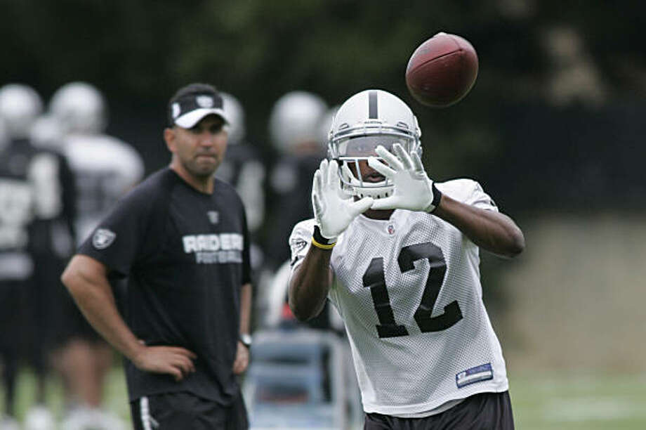 Under the watchful eyes of coaching staff, the Raider's newest recruit, #12 Darrius Heyward-Bey (WR) does pass catching drills at the Oakland Raiders training camp in Napa, Calif. on Friday, July 31, 2009.   Photo by Kat Wade / Special to the Chronicle Photo: Kat Wade, Special To The Chronicle