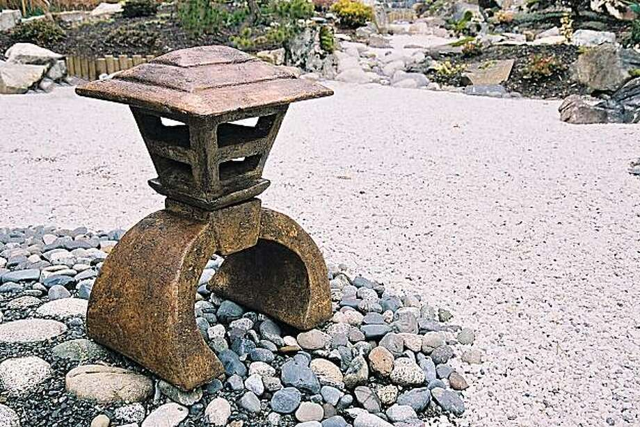 This product image shows Mashikaku Yukima-gata,snow lantern, designed by Brandon Vickerd. The piece comes in Pacific Moss and Ancient Stone. Photo: AP