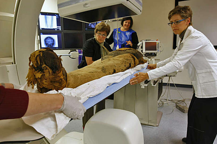 Elisabeth Cornu of the Fine Arts Museums of San Francisco ( left) Teri Moore and Dr. Rebecca Fahrig( right) rotate the 2000 year-old mummy to get a different CT scan at the Stanford Medical Center,  Thursday August 20, 2009, in Palo Alto, Calif. Photo: Lacy Atkins, The Chronicle