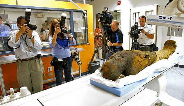 Members of the media gather around the mummy to report on the scanning at Stanford Medical Center. Photo: Lacy Atkins, The Chronicle