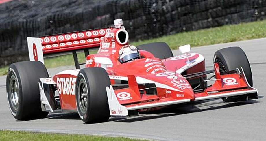 Driver Scott Dixon drives through turn twelve during the Honda Indy 200 at Mid Ohio Sports Car Course in Lexington, Ohio Sunday, Aug. 9, 2009. (AP Photo/Tom E. Puskar) Photo: Tom E. Puskar, AP