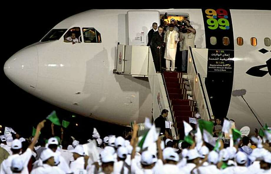Libyan Abdel Baset al-Megrahi, who found guilty of the 1988 Lockerbie bombing, top  left, is accompanied by Seif al-Islam el- Gadhafi, son of Libyan leader	Libyan leader Moammar Gadhafi upon his arrival at airport in Tripoli, Libya, Thursday, Aug. 20, 2009 after Scotland freed the terminally ill Lockerbie bomber on compassionate grounds Thursday, allowing him to die at home in Libya despite American protests that mercy should not be shown to the man responsible for the deaths of 270 people. (AP Photo/ Amr Nabil) Photo: Amr Nabil, AP