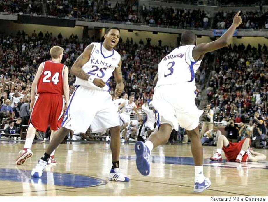 ###Live Caption:Kansas Jayhawks' Brandon Rush (25) and Russell Robinson (3) celebrate as the Davidson Wildcats miss a last second shot giving Kansas the victory in their NCAA men's Midwest Regional finals basketball game in Detroit, March 30, 2008. REUTERS/Mike Cassese (UNITED STATES)###Caption History:Kansas Jayhawks' Brandon Rush (25) and Russell Robinson (3) celebrate as the Davidson Wildcats miss a last second shot giving Kansas the victory in their NCAA men's Midwest Regional finals basketball game in Detroit, March 30, 2008. REUTERS/Mike Cassese (UNITED STATES)###Notes:Kansas Jayhawks' Rush and Robinson celebrate as Davidson miss a last second shot giving Kansas the victory in their NCAA men's basketball game in Detroit###Special Instructions: Photo: MIKE CASSESE
