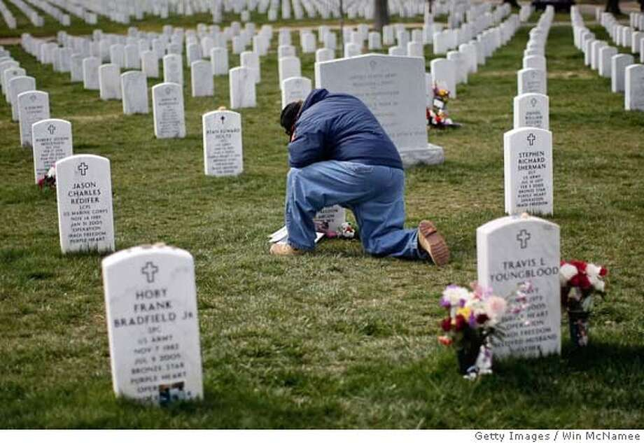 ###Live Caption:ARLINGTON, VA - MARCH 24: Mike Rosen visits the grave of his friend, Sgt. Michael Carlson who was killed while fighting in Iraq, in Section 60 at Arlington National Cemetery March 24, 2008 in Arlington, Virginia. A new milestone was reached yesterday as more than 4,000 U.S. troops have been killed in the war in Iraq. (Photo by Win McNamee/Getty Images)###Caption History:ARLINGTON, VA - MARCH 24: Mike Rosen visits the grave of his friend, Sgt. Michael Carlson who was killed while fighting in Iraq, in Section 60 at Arlington National Cemetery March 24, 2008 in Arlington, Virginia. A new milestone was reached yesterday as more than 4,000 U.S. troops have been killed in the war in Iraq. (Photo by Win McNamee/Getty Images)###Notes:Iraq War US Soldier Death Toll Hits 4000###Special Instructions: Photo: Win McNamee