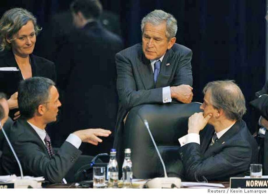 ###Live Caption:U.S. President George W. Bush talks with Norwegian Prime Minister Jens Stoltenberg (L) and Norwegian Foreign Minister Jonas Gahr Store (R) at the NATO Summit in Bucharest April 3, 2008. REUTERS/Kevin Lamarque (ROMANIA)###Caption History:U.S. President George W. Bush talks with Norwegian Prime Minister Jens Stoltenberg (L) and Norwegian Foreign Minister Jonas Gahr Store (R) at the NATO Summit in Bucharest April 3, 2008. REUTERS/Kevin Lamarque (ROMANIA)###Notes:Bush talks with the Norwegian Prime Minister at the NATO Summit in Bucharest###Special Instructions:0 Photo: KEVIN LAMARQUE
